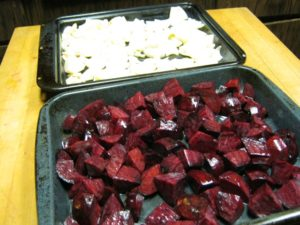 Red beets and onions getting ready to be roasted.